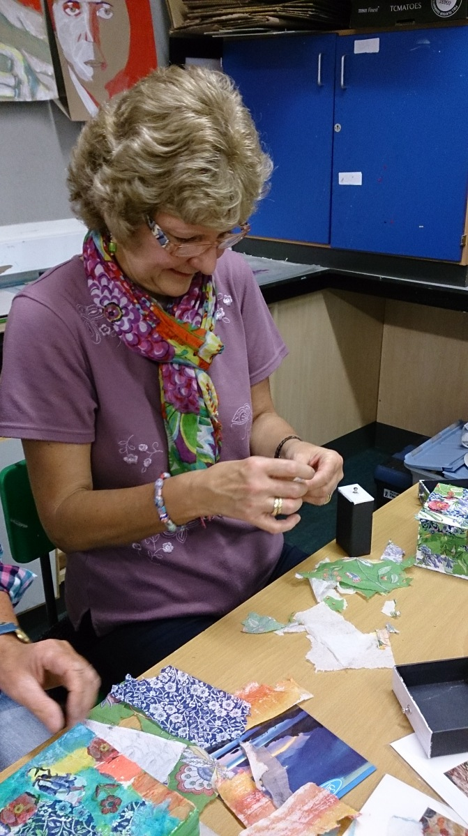 Woman doing a paper collage