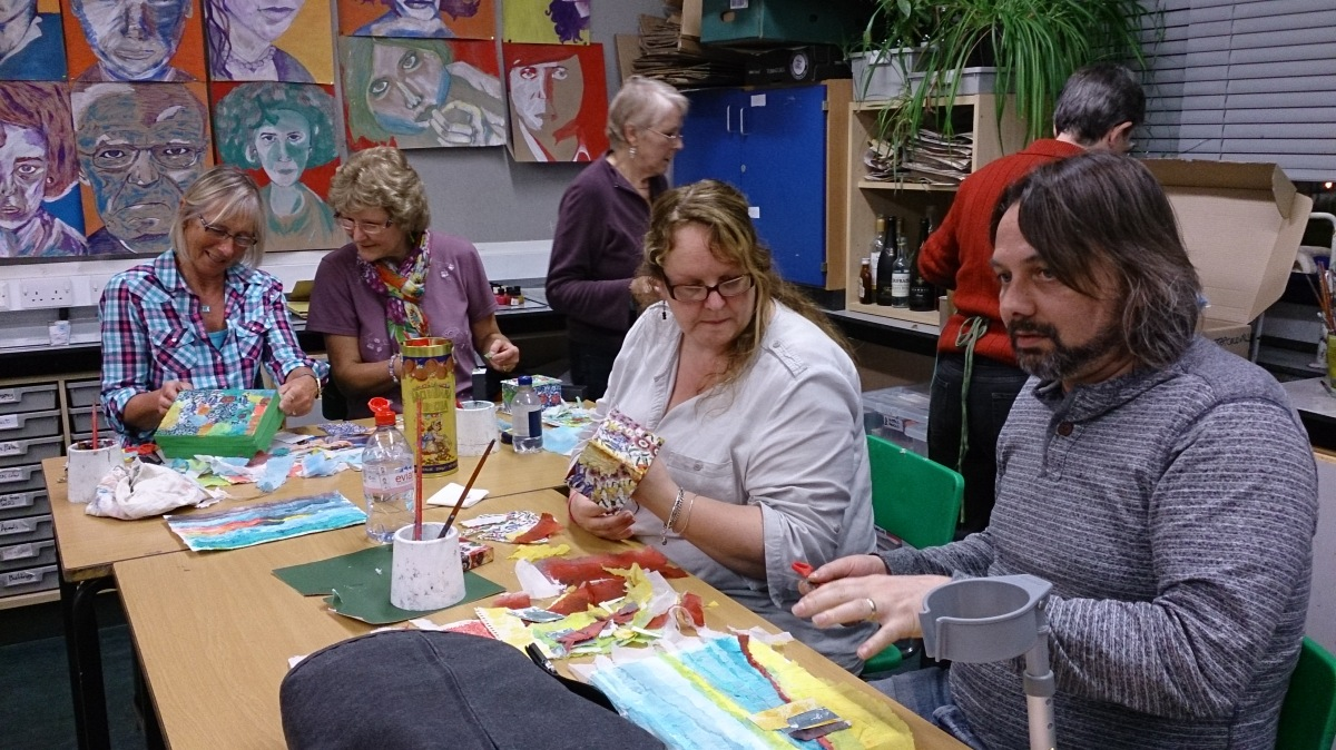 six people in an art lesson