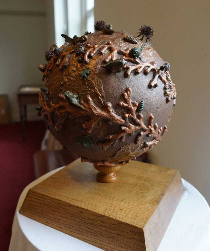 New Beginning Dudley Evans globe sculpture with creatures