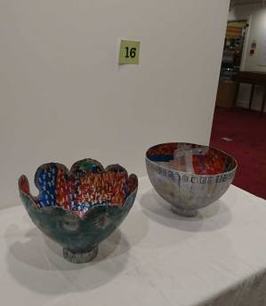 Consequences exhibit two papier mache bowls