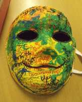 Yellow green painting mask, smiling, with words