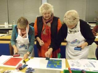three women printing on gelli plates