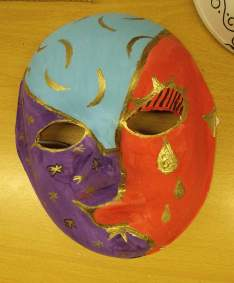 red blue purple mask with gold detail