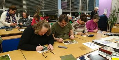 an art class concentrating on their work