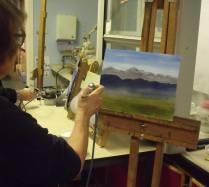 Woman airbrushing