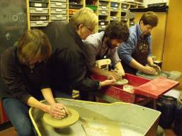 A production line of potters