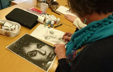 Woman drawing a portrait
