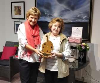 Sandra White, right, receives the Gordon Crisell Shield from Angela Wood